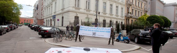 Activists protest against Iranian regime's role in Syria in front of Iranian embassy in Vienna ahead of nuclear talks